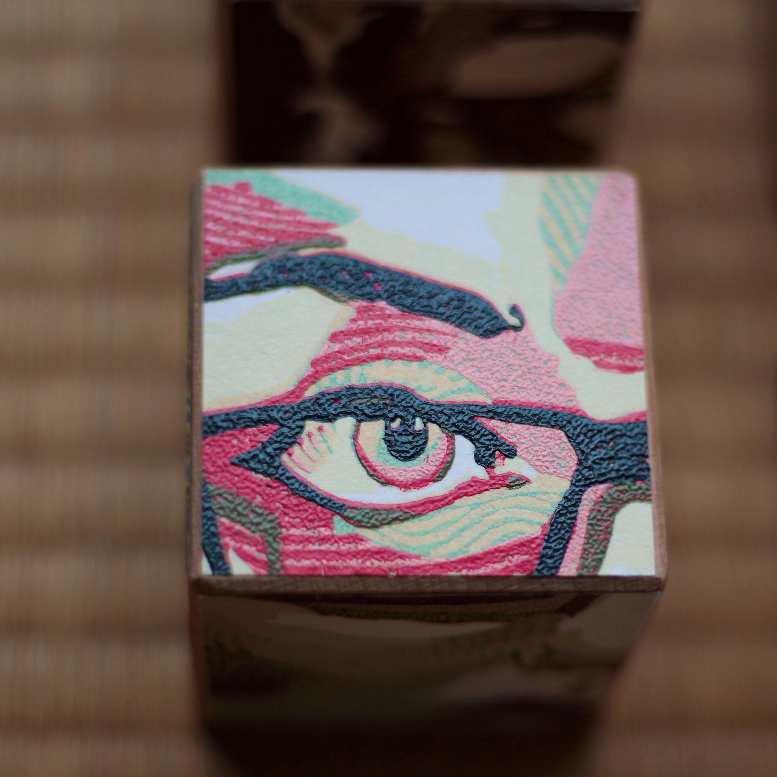 Linocut print on cube object