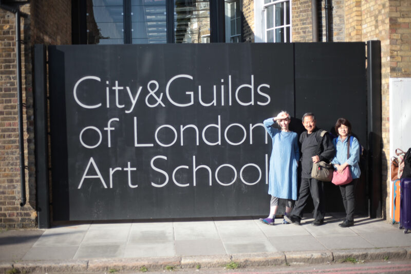 Louise Rouse standing outside City & Guilds London Art School with Motoharu Asaka